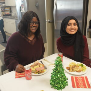 Two employees at holiday lunch