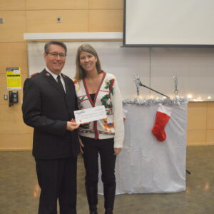 Employee presenting cheque to Salvation Army