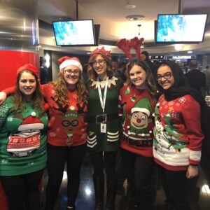 Employees in holiday sweaters
