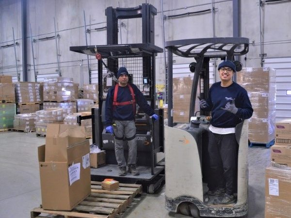 Employees at Distribution Centre on forklifts