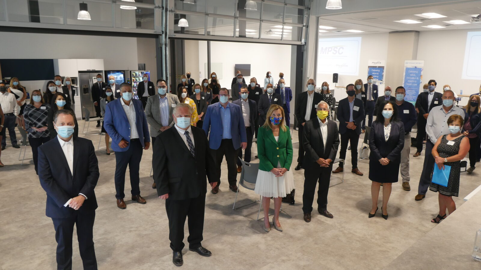 Premier Doug Ford and team wearing masks while visiting Mohawk Medbuy and Plexxus